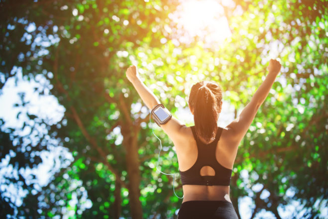 woman engaged in healthy habit building like exercising